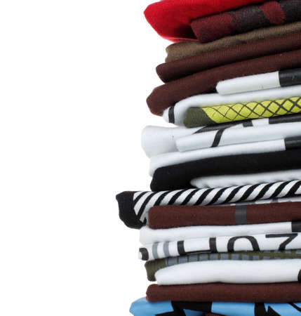 Row of colorful cotton t-shirts over white background photo