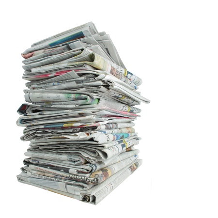 newspaper: shot of stack of newspaper over white background Stock Photo