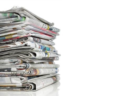 shot of stack of newspaper over white background photo