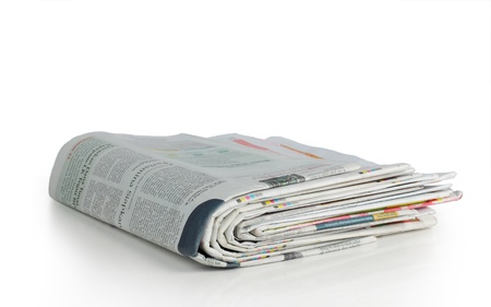 shot of stack of newspaper over white background Stock Photo