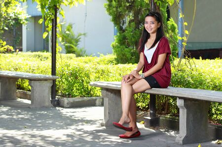 attractive asian woman sitting outdoor in the park Stock Photo - 8696732