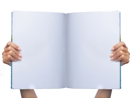 man holding book: hand holding magazine