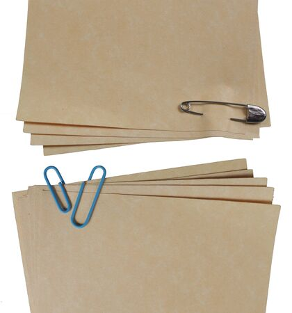 brown paper attached by some different type of paper clip photo