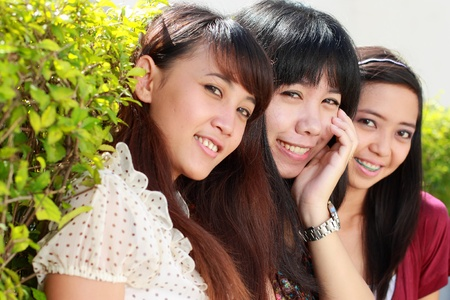 asian girl best friends having fun in the park photo