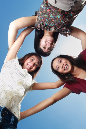 asian teenager: young asian woman having fun with friends