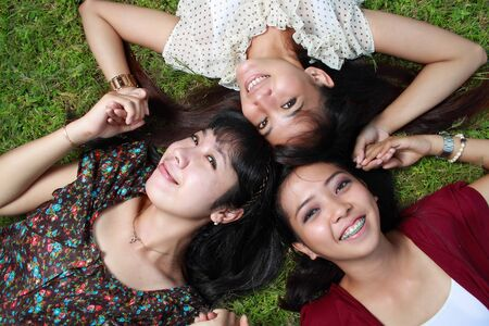 young asian woman having fun with friends photo
