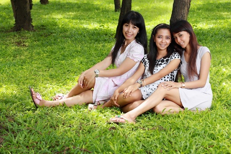 young asian woman picnic with friends photo