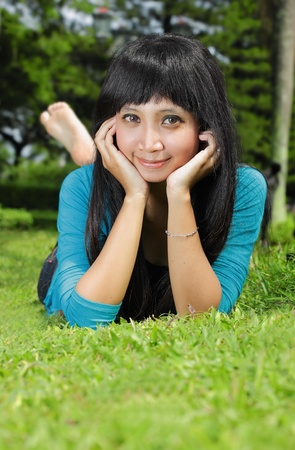 young beautiful smiling woman outdoors photo