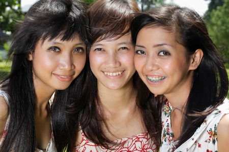 close up portrait of three girl friend with lovely smiling photo