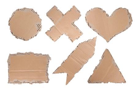 cardboard with unique shape like heart, circle, triangle, cross and arrow photo