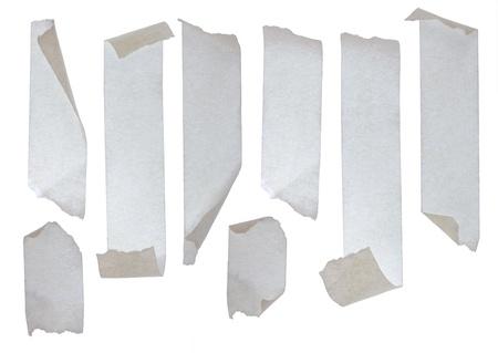 cintas: Tiras de cinta adhesiva. Aislados sobre fondo blanco. Foto de archivo