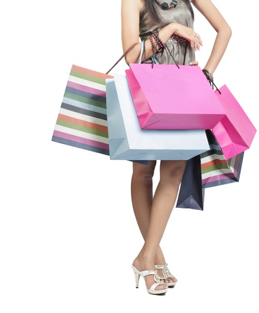 Beautiful stylish woman holding shopping bags in both hands photo
