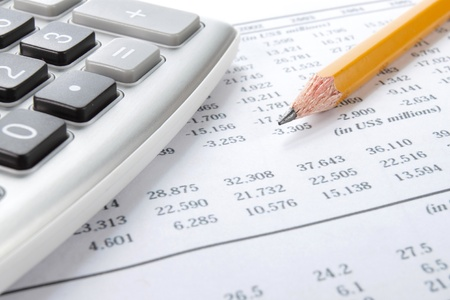Business background, market analysis concept with financial data, pencil and calculator photo
