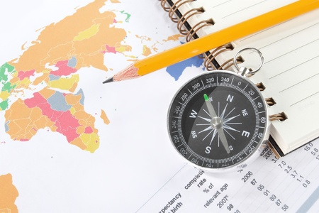 World map business background with compass and pencil photo