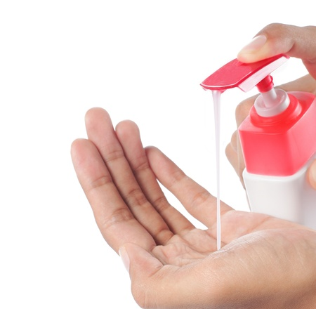 sanitizer: Female hands using hand sanitizer. isolated over white background