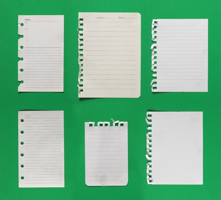 collection of paper. isolated over green background photo