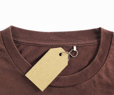 ripping shirt: price tag hang over brown tshirt. isolated over white background