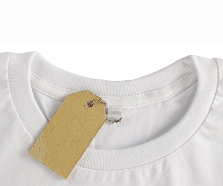 tshirt: blank price tag hang over white tshirt. isolated over white background