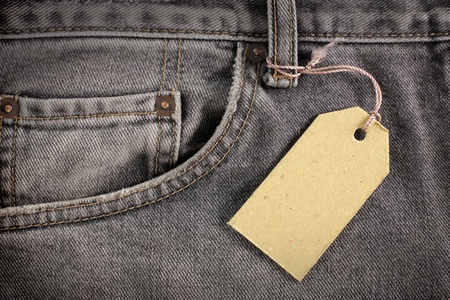 sew tags: denim jeans background with price tag
