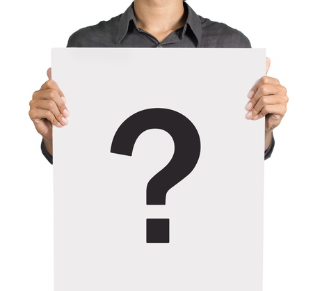 Young man standing with question mark on white board