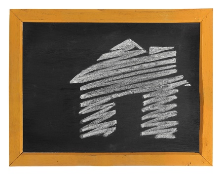 house icon hand-drawn over the blackboard with white space for your text photo