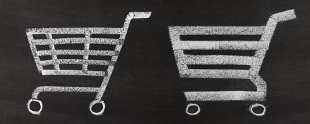 Shopping cart icon, hand drawn by chalk over blackboard photo