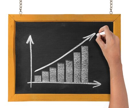 hand drawing chart representing growth on blackboard Stock Photo - 9469617