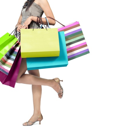 Beautiful woman with a lot of shopping bags photo