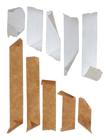 messed: brown and white Strips of masking tape. Isolated on white background.