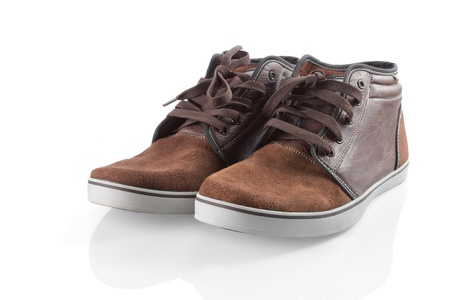 brown sneakers isolated over white background photo