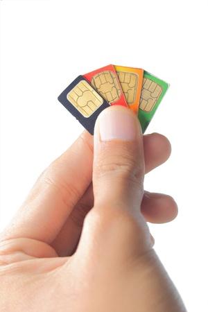 Sim-Karte in der Hand isoliert auf weißem Hintergrund Standard-Bild - 9686708