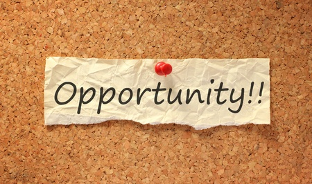 opportunity sign on corkboard attached with thumbtack Stock Photo
