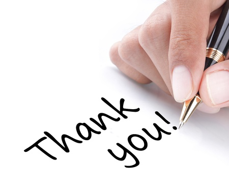 Hand writing thank you, isolated on white background photo