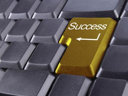 Computer keyboard - golden key Success photo