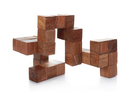 hölzerne Puzzle isolated on white background