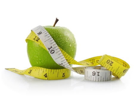 fresh apple with measuring tape. diet concept, loss weight photo