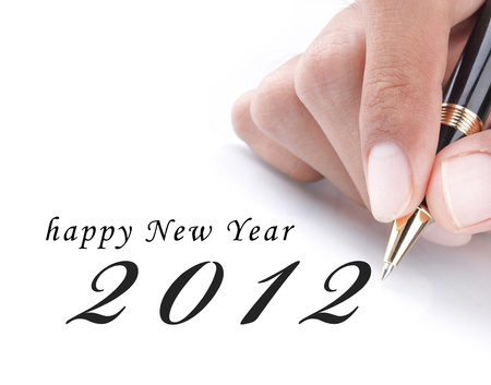 gesture of hand write happy new year 2012 photo