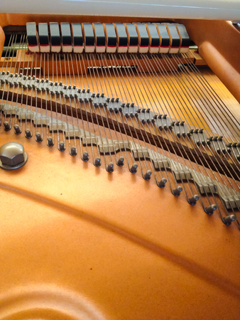 wire pin: Wird behide the grand piano Stock Photo