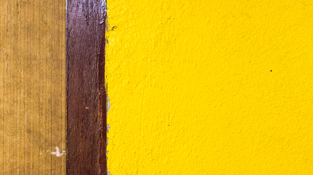 dark backgrounds: Color Strip, brown, dark brown and yellow, on the texture wall.