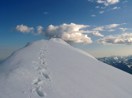 Footprints in the Snow Leading to a Mountain Summit