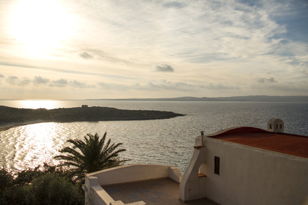 Traditional Sardinian sea house overlooking a breathtaking view at sunset