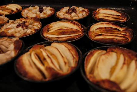 Small homemade apple pies freshly baked each in its mold