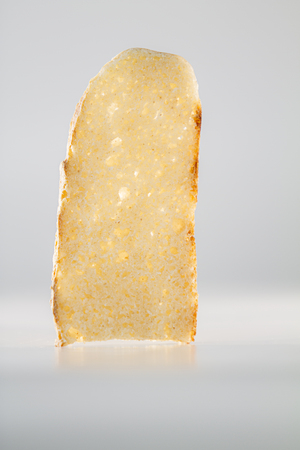 The purity and simplicity of a slice of homemade bread highlighted by the back lighting