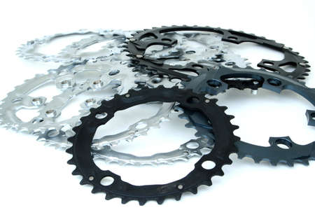 A mess of sprockets on white.