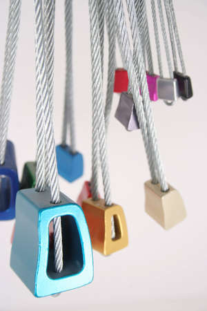 Colorful nuts on braided steel cable used as passive protection while rock climbing.