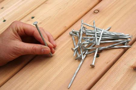 Nailing new cedar decking. Stock Photo - 440158