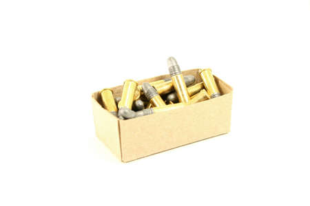 calibre: An isolated box full of 22 calibre rifle bullets against a white background. Stock Photo