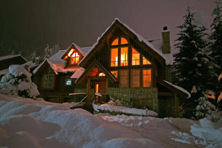A winter home in Whistler, BC blanketed by a fresh dumping of snow.  Slightly grainy, but warm.