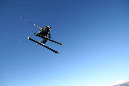 businesslike: A skier in a business-like pinstripe suit flies through the air in Whistler, BC.