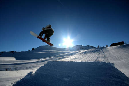 A snowboarder takes flight in Whistler, BC.